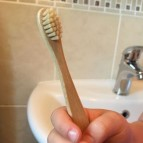 Bamboo 'Junior' Toothbrush with Bamboo Bristles - in Use
